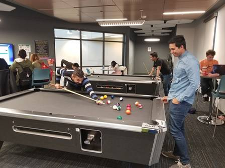 Students playing on pool table