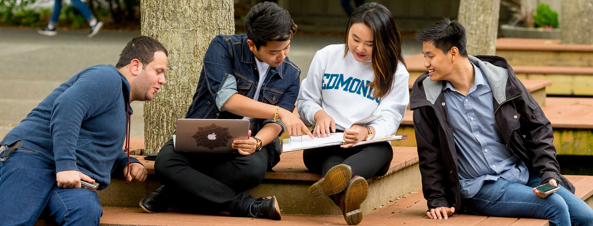 Students sitting on a bench in the courtyard