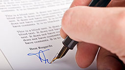 person signing a letter