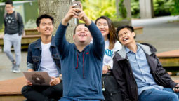 students taking a selfie in the courtyard